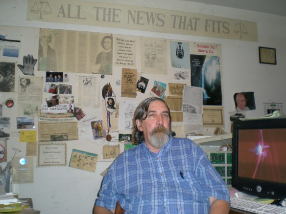 Editor Don Russell sits beneath the mantra for the paper, he will print almost anything that fits.
