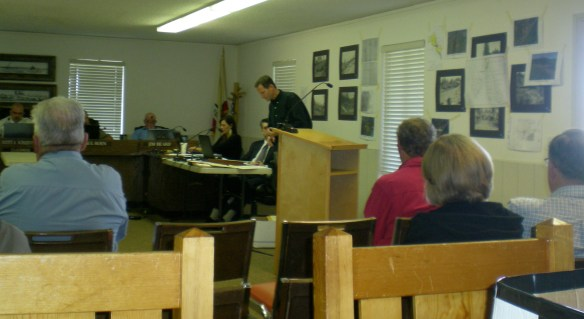 Assistant Planning Director Brandon Pangman prepares Exhibits and maps for Public Hearing on Church property request.
