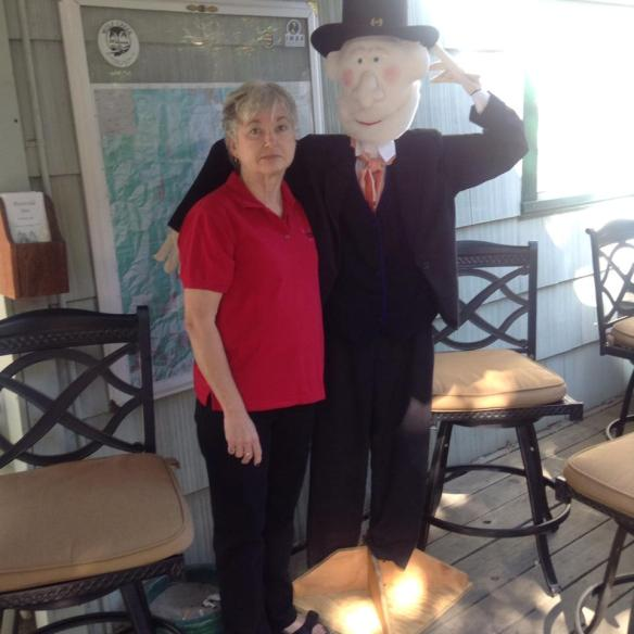 Nancy Carnahan Riverside Inn proprietor visits with Major Downie during the Clampers weekend