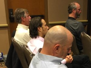 White Wolf owner Troy Caldwell and TNF Supervisor Eli Ilano buddy it up in the back row at the presentation.