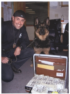 Officer Dan Casabian and his K-9 Brutus on a successful mission.