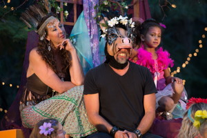 Titania, queen of the fairies (Tanya Zaleschuk) fawns over the newly-transformed Botton (Jason Crockett), as fairy Peaseblossom (Maya Johnson) looks on.  Photo by Susan Morning
