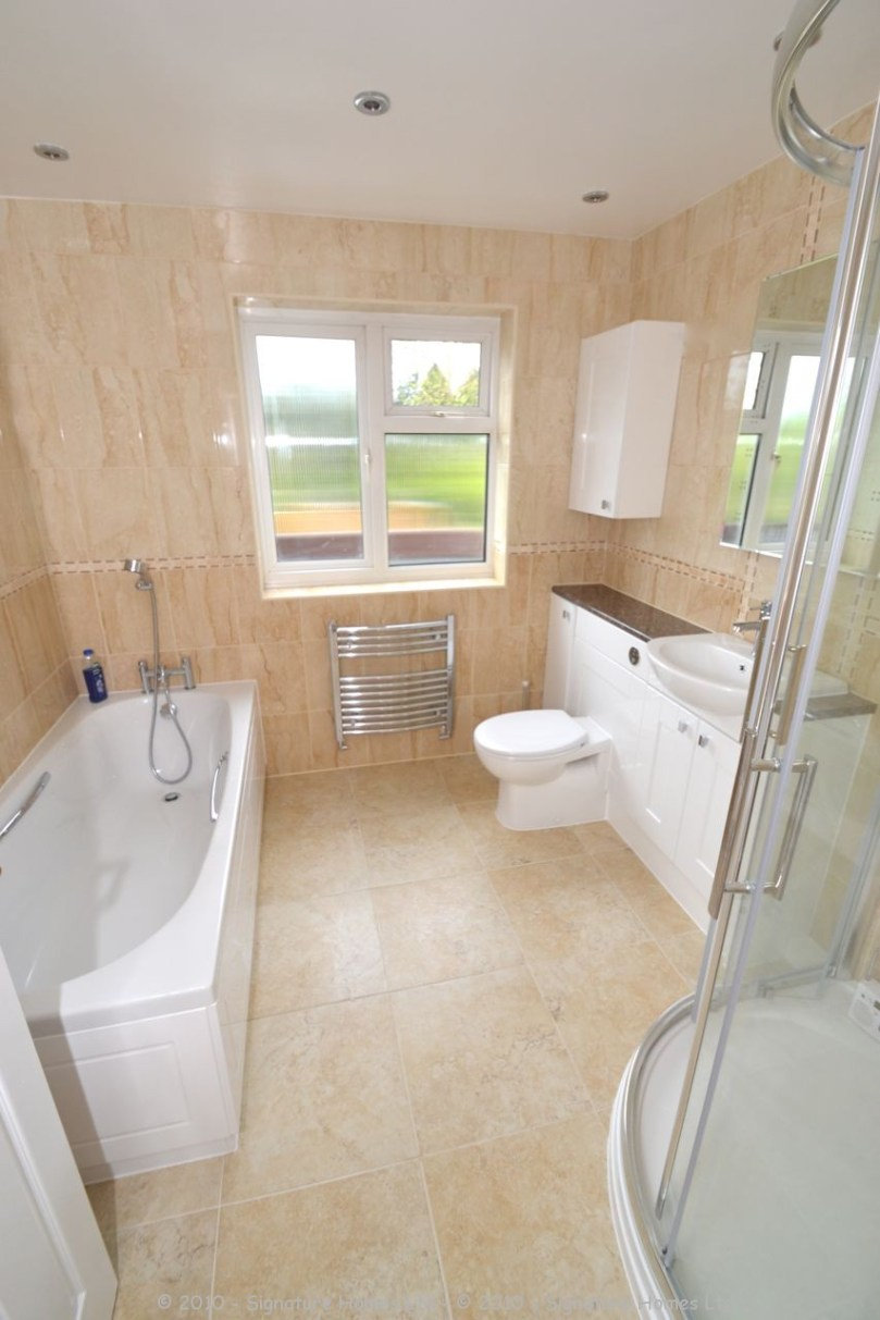 Fitted Bathroom with knock through in Banstead - 8