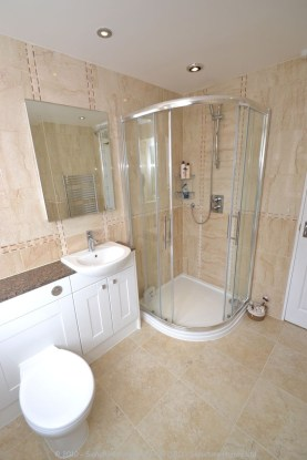 Fitted Bathroom with knock through in Banstead - 3