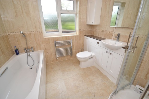 Fitted Bathroom with knock through in Banstead - 1