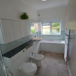 Light & Spacious Fitted Bathroom with pentagon shower enclosure – Woodcrest Road Purley