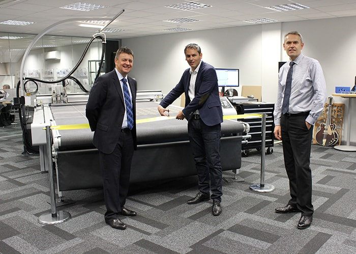 (L-R) Zünd UK Managing Director Tim Taylor, Zünd CEO Oliver Zünd and Zünd UK Sales Director Peter Giddings officially cut the ribbon on the revamped demo suite
