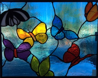 Donna Karl, Butterflies flutter through this lovely stained glass panel, their colors sublime.