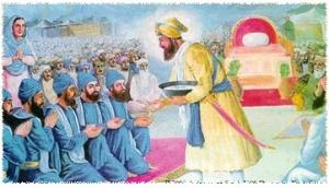 Guru Gobind Singh initiating the first five members of the Khalsa