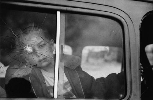 Kid and broken windshield