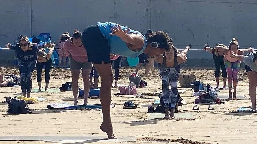 silent disco beach yoga at Watergate Bay newquay cornwall