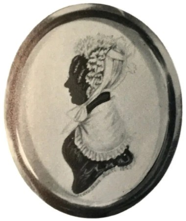 Silhouette of a lady with a bonnet facing left