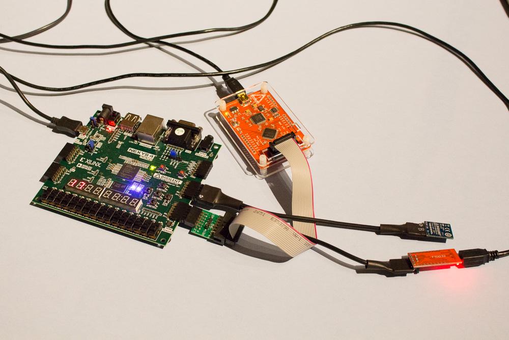 MIPSfpga+ allows loading programs via UART and has a