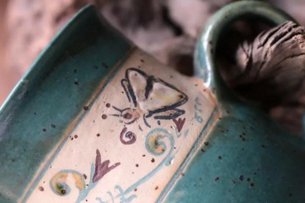Tasse mit Gartenmotiven