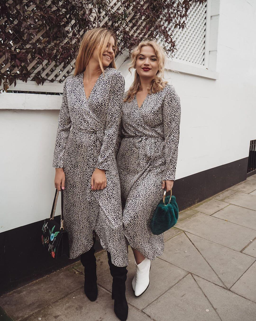 Two models wear the yondal leopard print dress on a london street