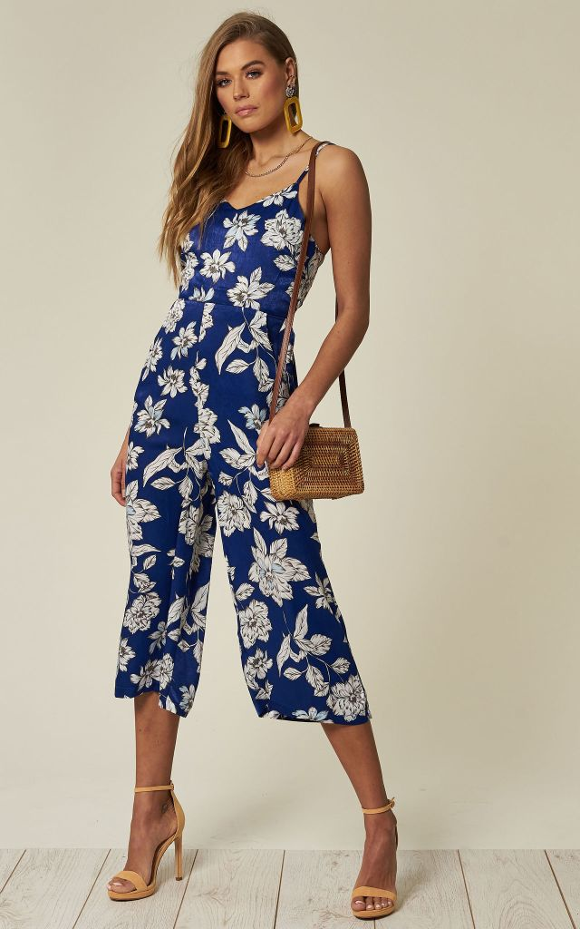 Strappy blue jumpsuit in white floral