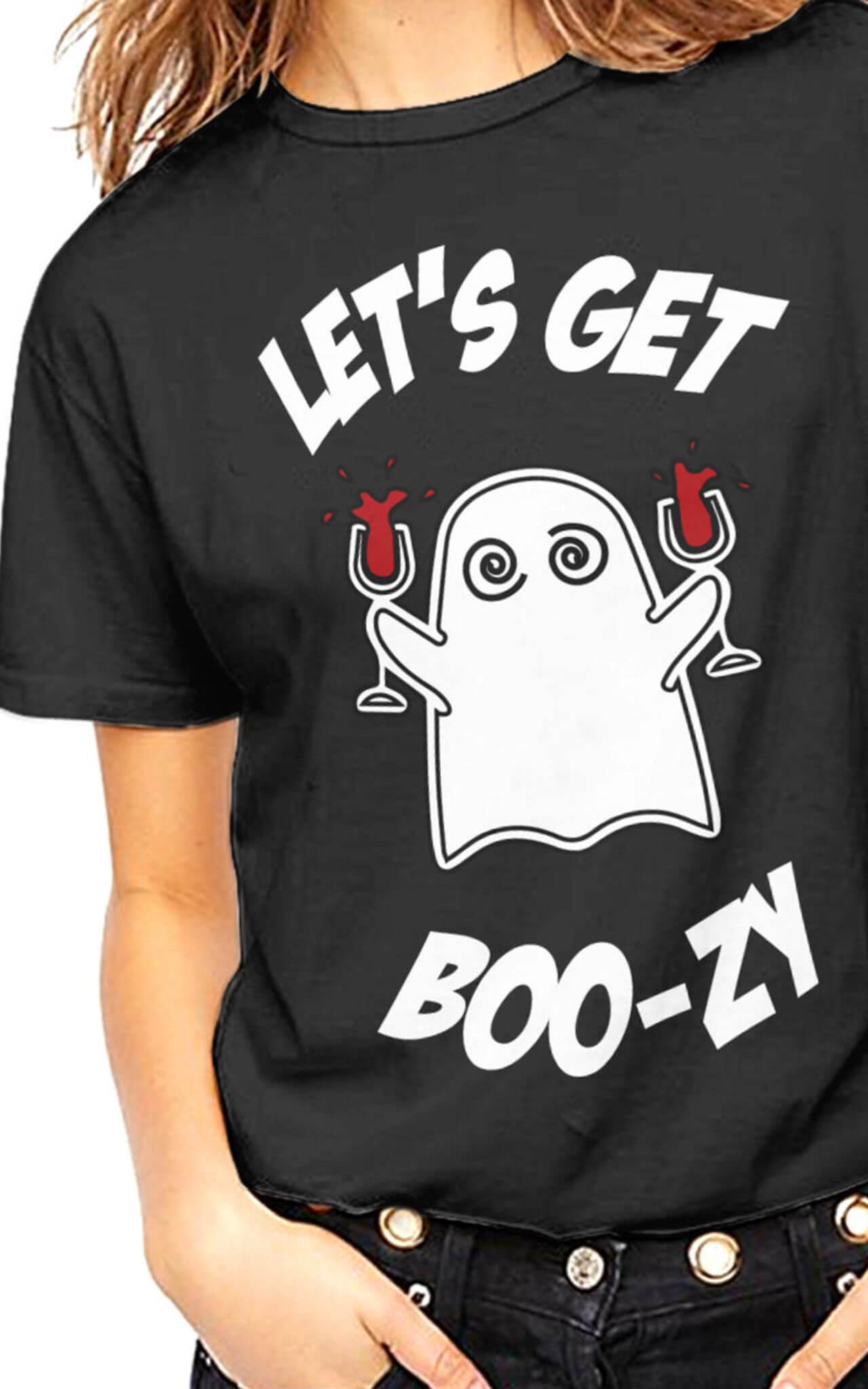 Model wears halloween slogan tee lets get boo-zy
