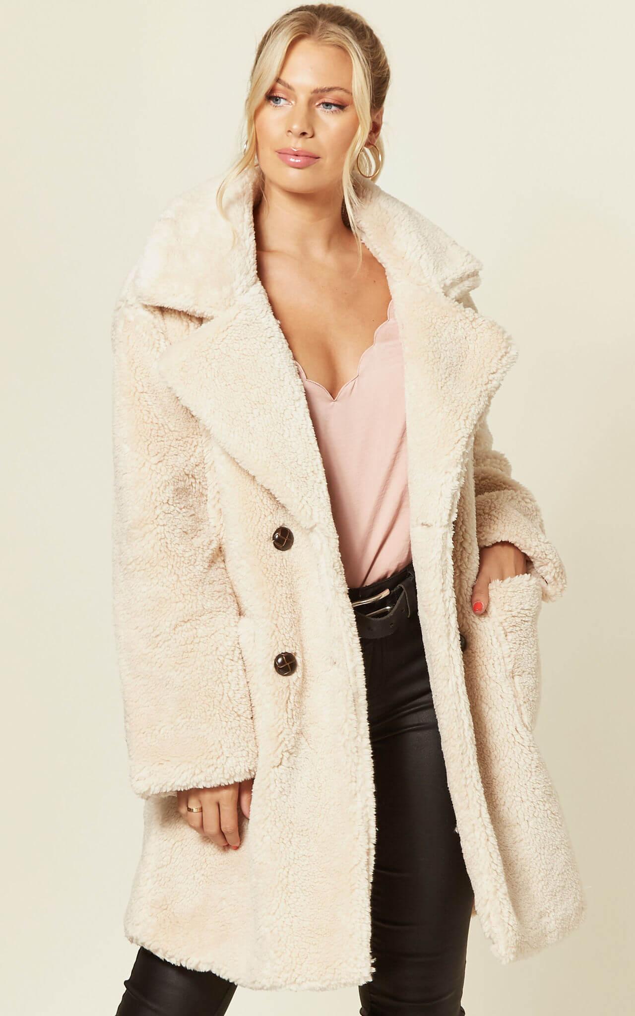Model wears a pale teddy coat