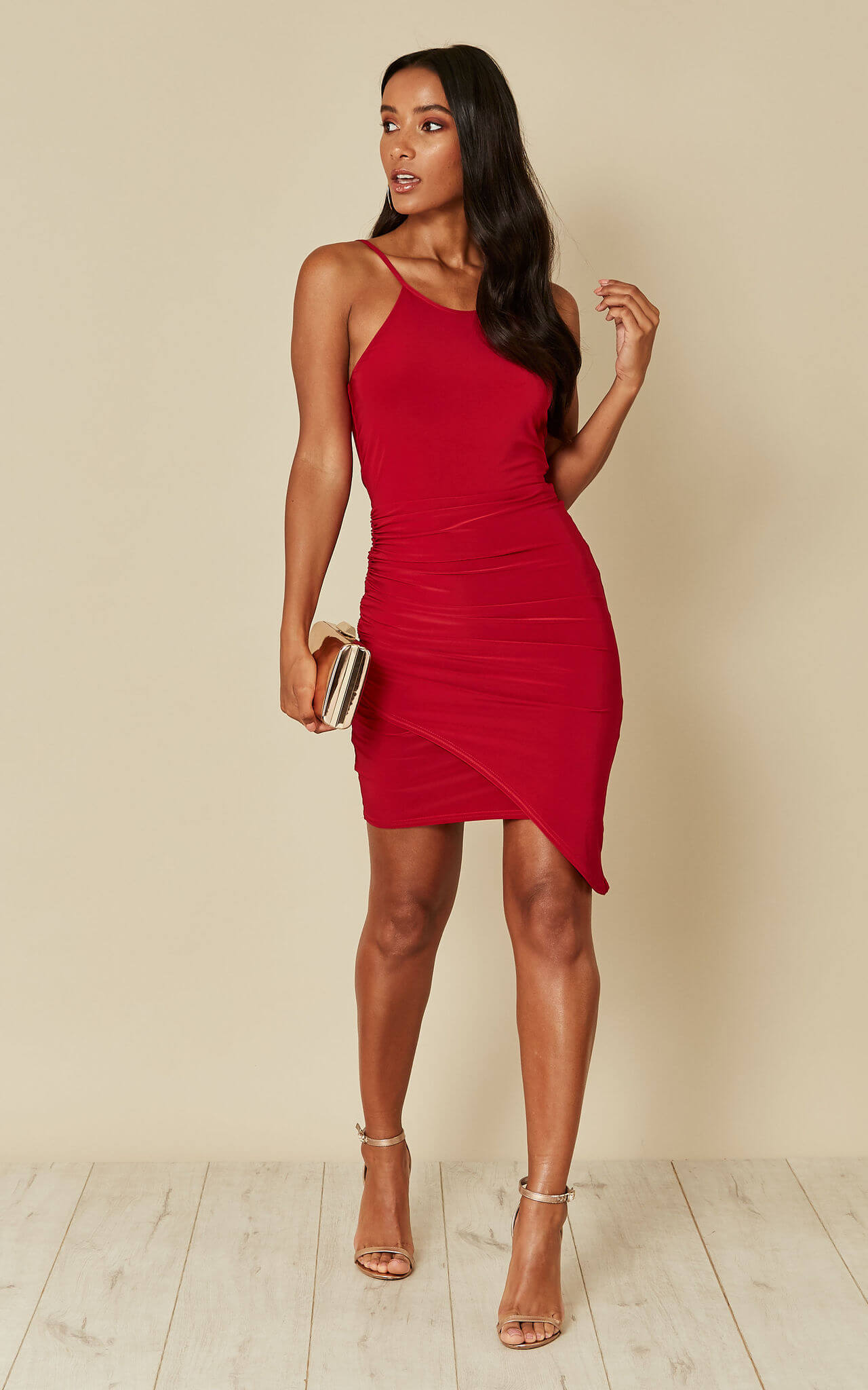 Model wears a red bodycon mini dress