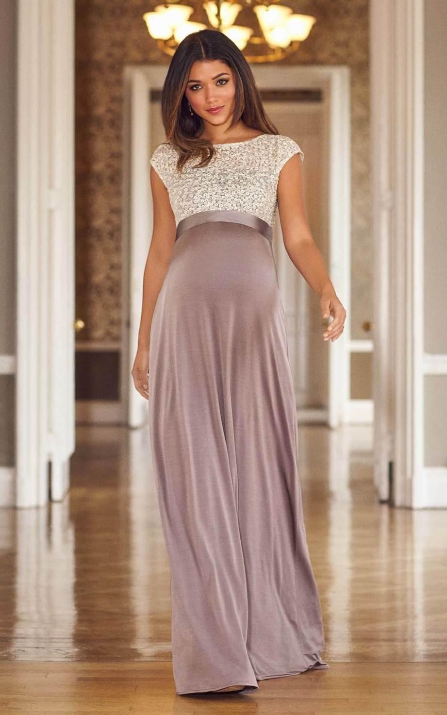 Pregnant model walks towards camera in dusky pink maxi dress