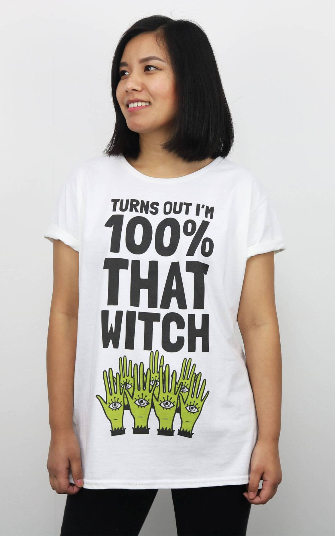 Model wears halloween slogan tee Turns Our I'm 100% That Witch