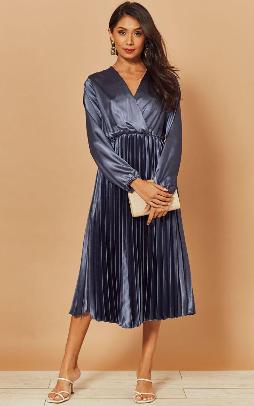 Model wears a satin style pleated dress