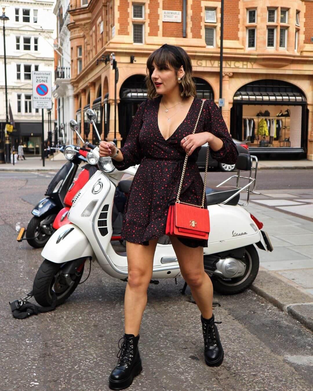 London influencer wears starry wrap mini dress posing in the street