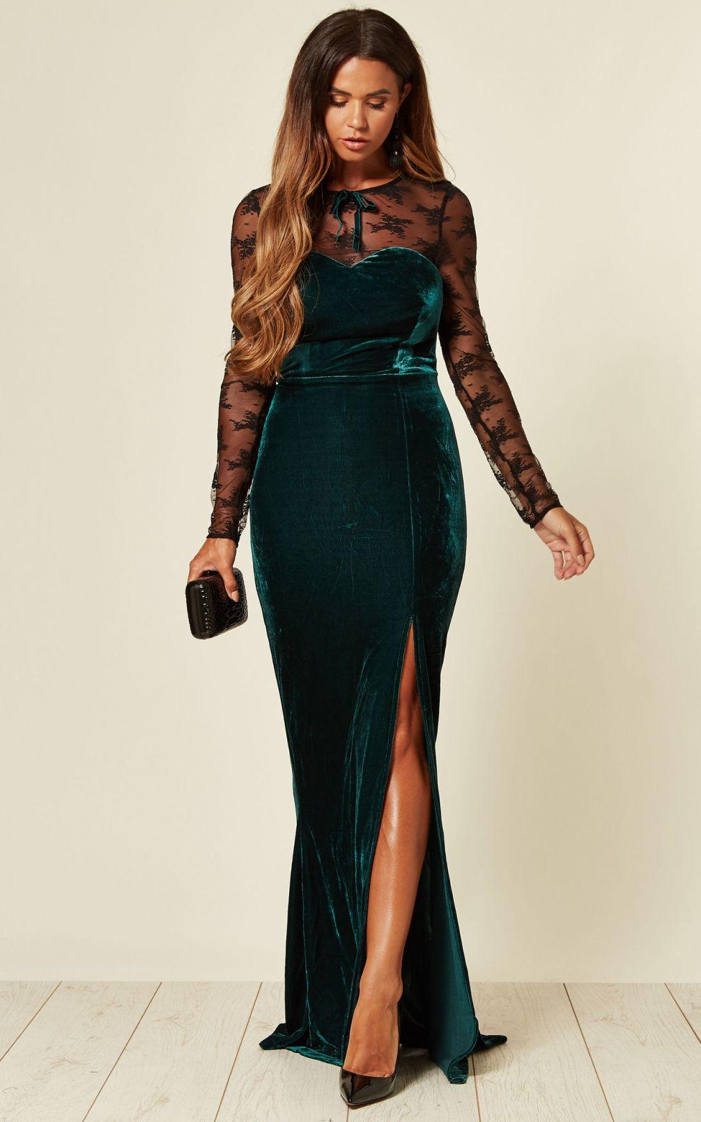 Model wearing teal velvet maxi dress