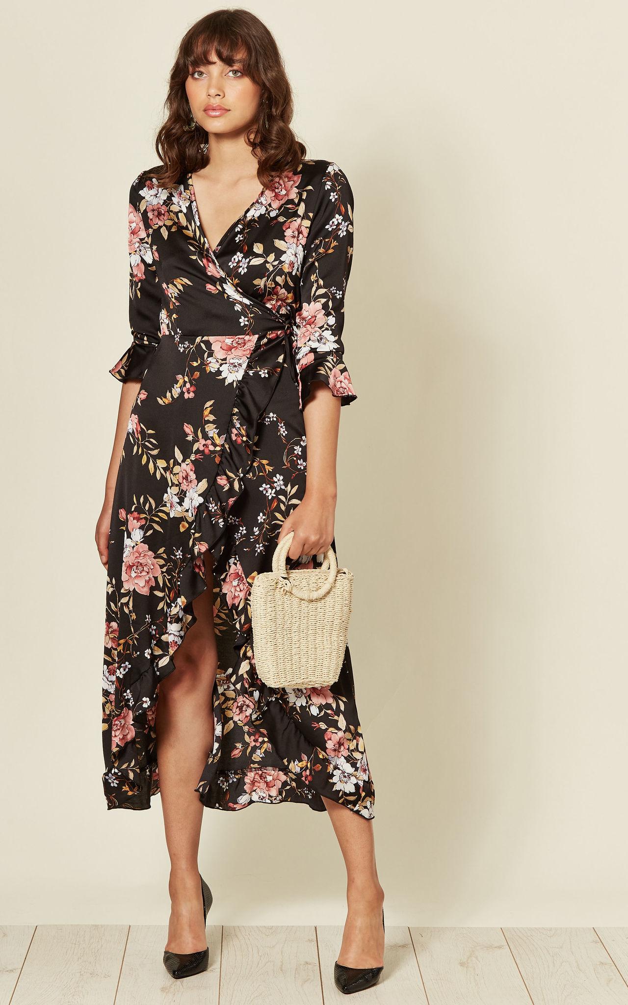 Model wears a frill wrap dress in floral