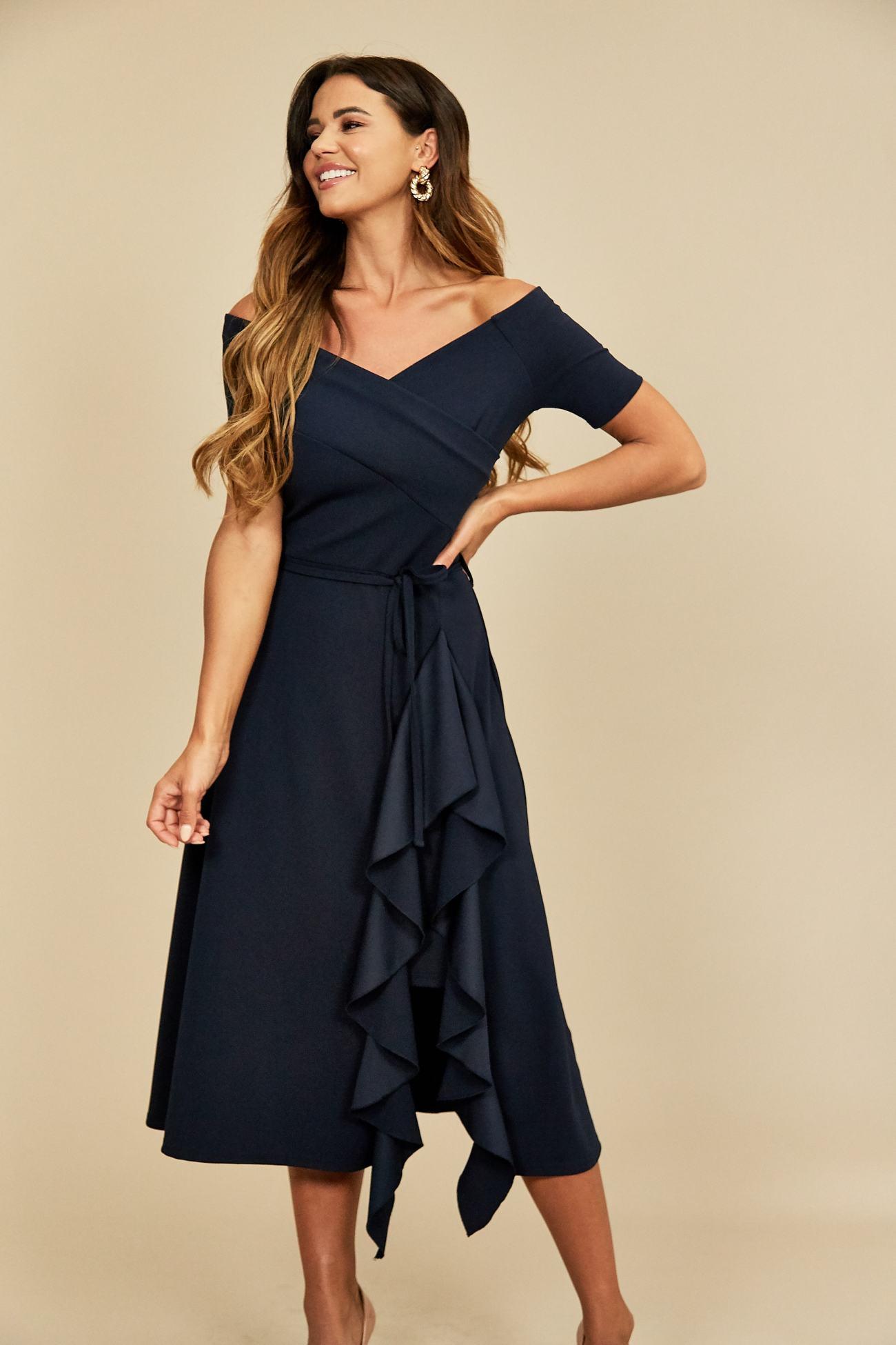 Model wears navy bardot frill midi dress