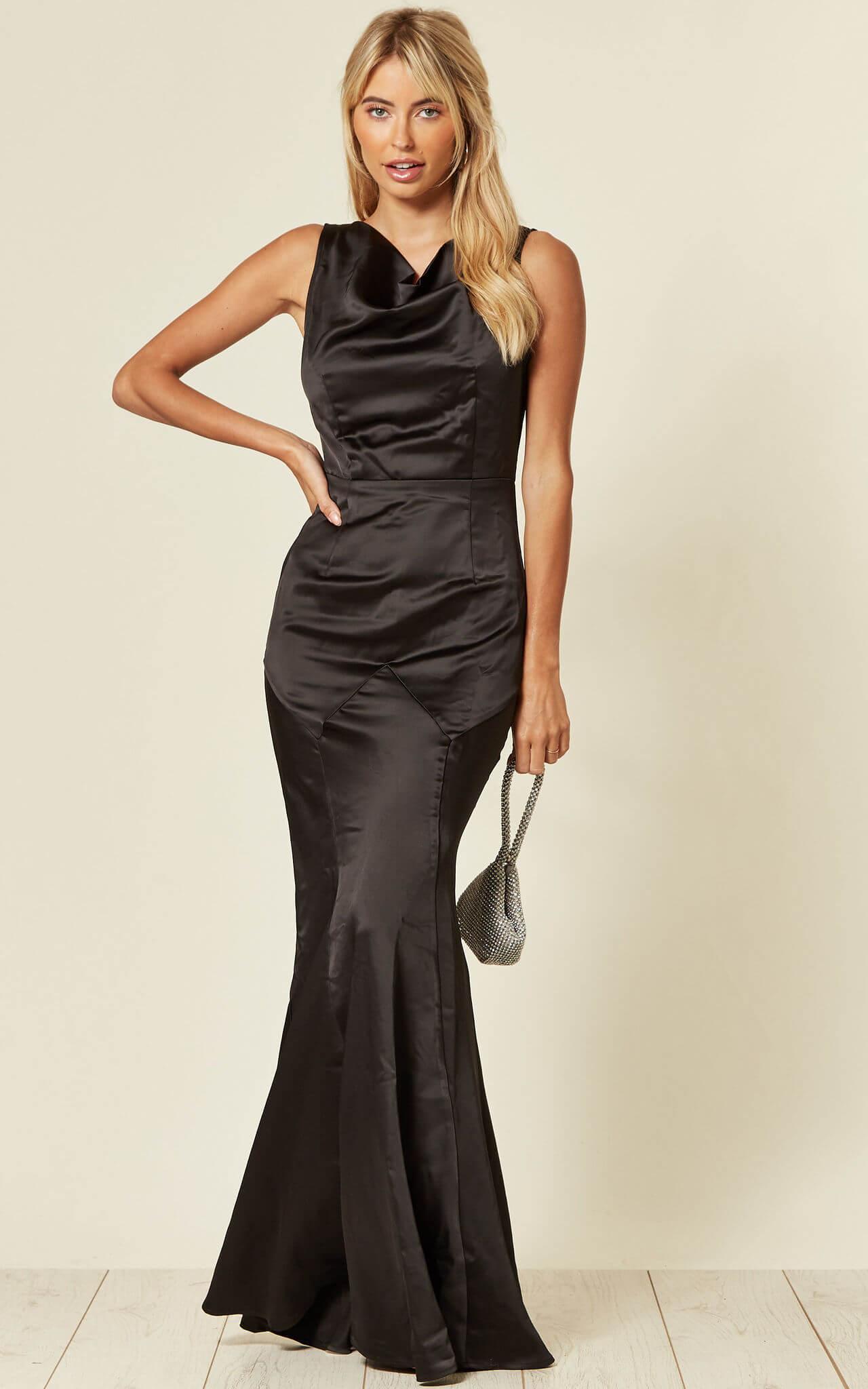 Model wears a fishtail prom evening black dress