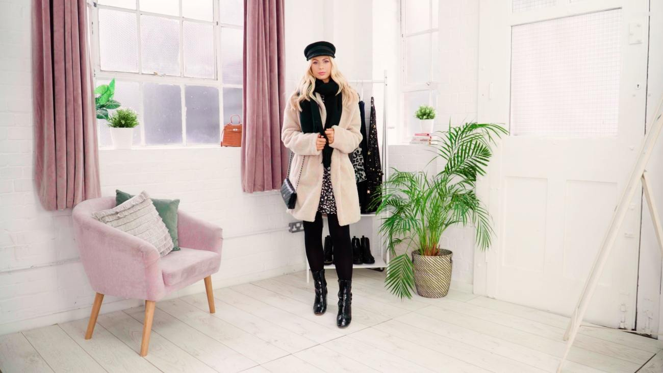 dress worn with boots styled for winter