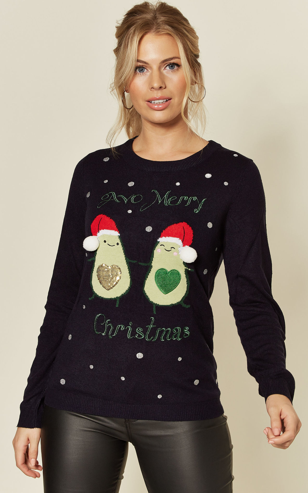 Model wears a navy embroidered avo merry christmas jumper with avocado embroidery