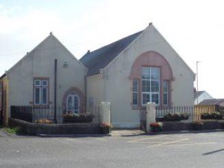 cream building with railings around