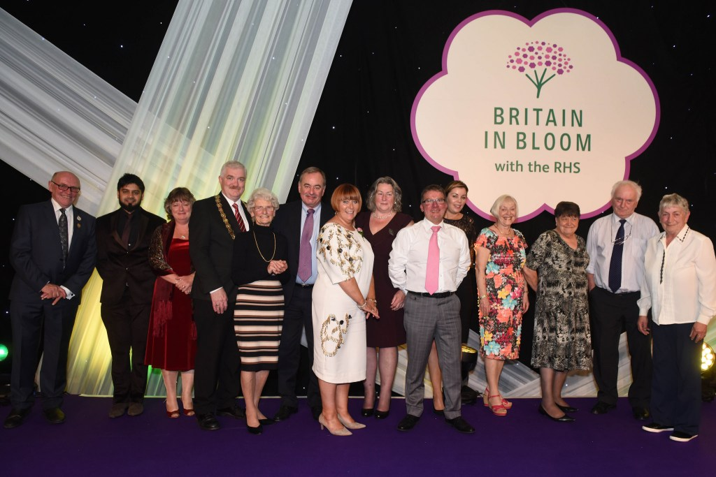 people on stage at britain in bloom presentation