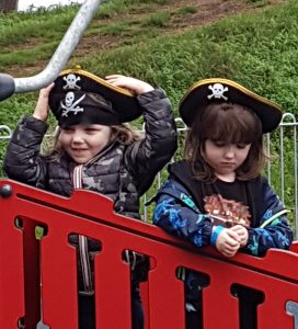 children with pirate hats on