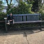 ray lonsdale sat on oversized bench