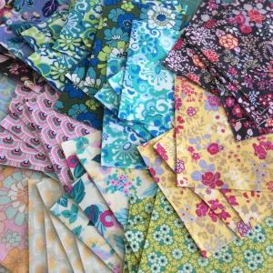 Working with these lovelies today freespiritfabric margotelena libraryofflowersfabric sillymamaquilts happyhellip