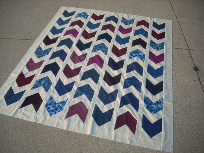 marine and burgundy arrow quilt top finish