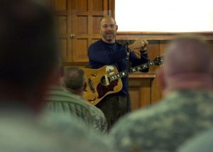 Silouan speaking to soldiers and civilians at Camp Atterbury.