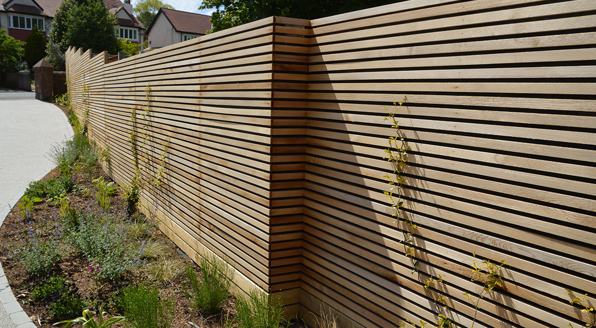 Contemporary Driveway On A Slope Fenced In Using Western Red Cedar Slatted Screens Silva Timber