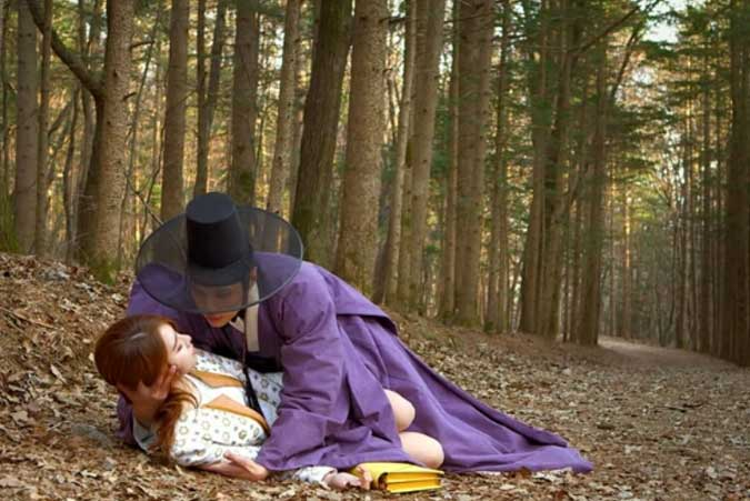 Boong-Do catches Hee-Jin as she faints