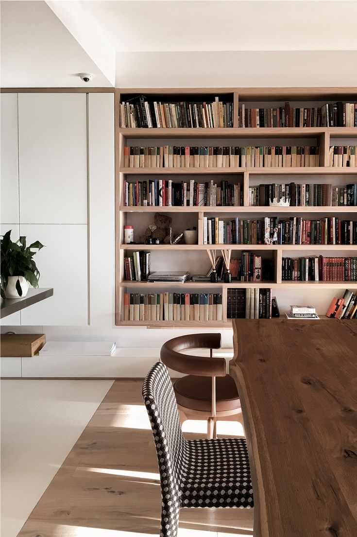 I like that the bookshelves have vertical dividers in different locations