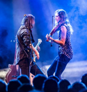 picture of two of the band performing on stage