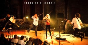 Picture showing The Urban Folk Quartet performing on stage