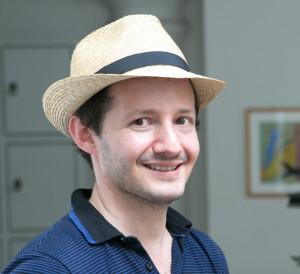 Simon Spiegel mit Strohhut