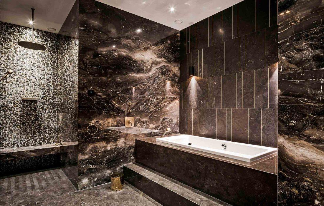 Elegant masculine bathroom with midnight pearl mosaic tiles