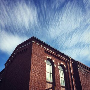 Textured clouds above a historic University of Arizona building.