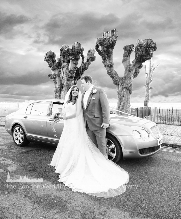 The couple and wedding car