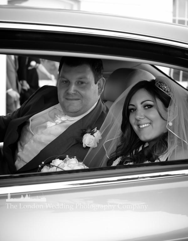 The couple in their wedding bentley